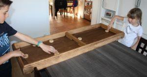 Location jeu en bois, table à élastique à louer